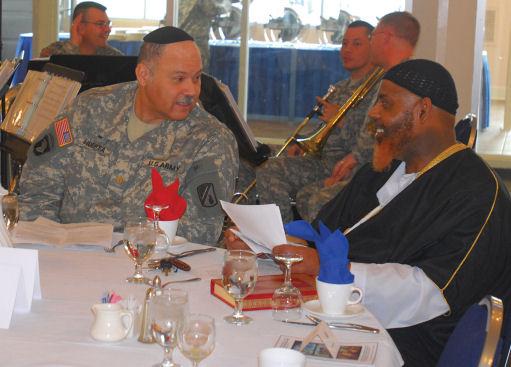 Jewish Chaplain (Maj) Carlos Huerta talks with Muslim imam Dawud Salahuddin Bin Pearson before the start of the National Prayer Breakfast. (US Army Photo)